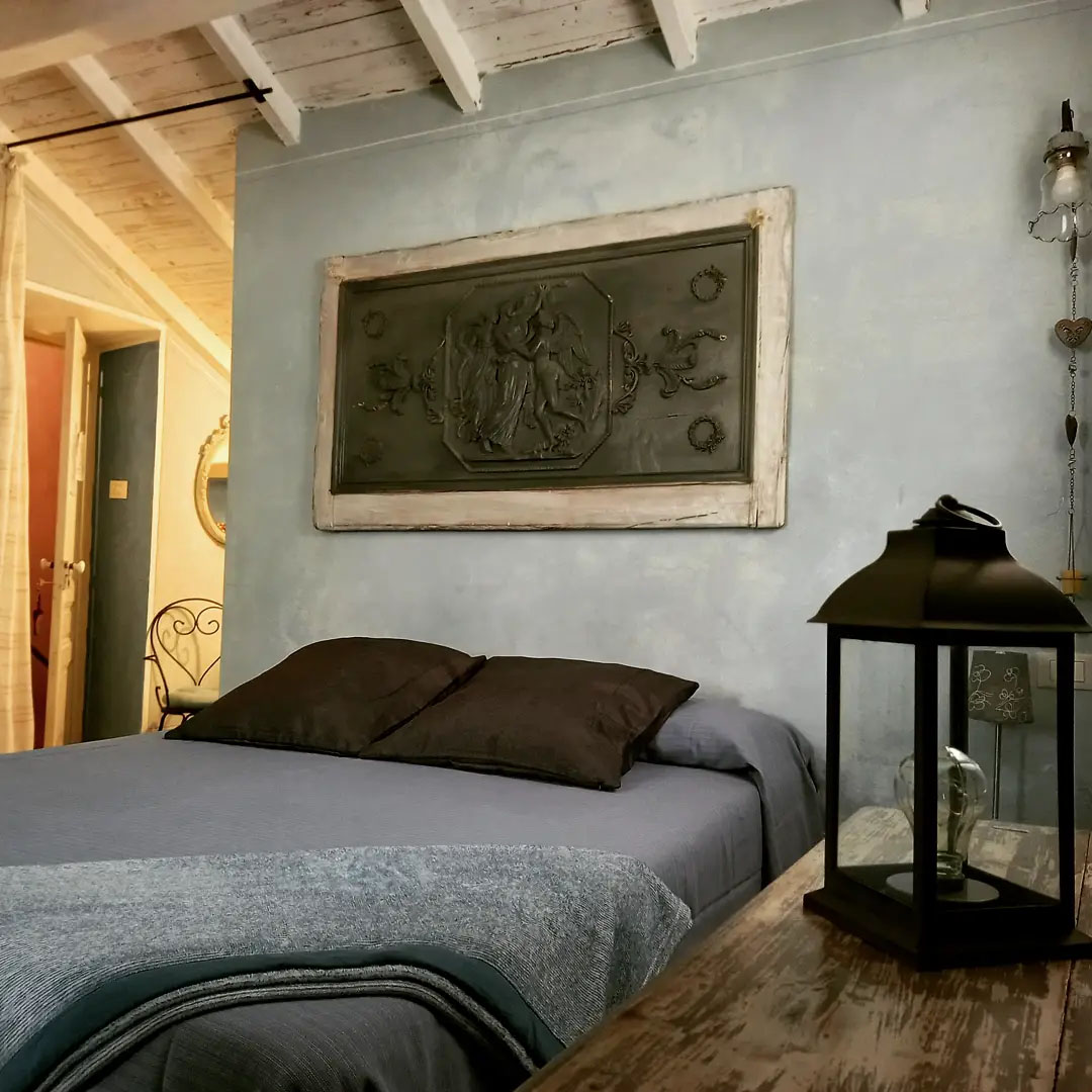 Les Romantique double bedroom with sloping ceilings